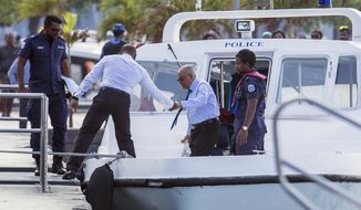 The Maldives longtime former dictator Maumoon Abdul Gayoom, center, arrives for a hearing at a criminal court in Male, Maldives, Wednesday, March 21, 2018. Authorities charged Gayoom and top judges and police officials with terrorism Tuesday as the government deals with political turmoil that prompted a weeks-long state of emergency. (AP Photo/Mohamed Sharuhaan)