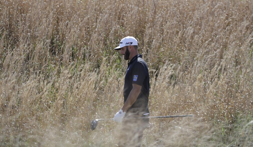 Defending champion Dustin Johnson walks along the on the 16th hole during round-robin play at the Dell Technologies Match Play golf tournament Wednesday, March 21, 2018, in Austin, Texas. (AP Photo/Eric Gay)