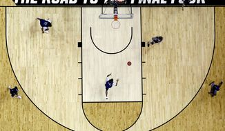 Nevada players workout during practice at the NCAA men's college basketball tournament Wednesday, March 21, 2018, in Atlanta. Nevada faces Loyola-Chicago in a regional semifinal on Thursday. (AP Photo/David Goldman)