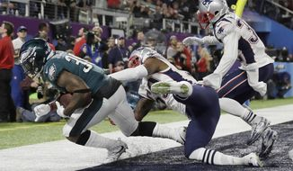 FILE - In this Feb. 4, 2018, file photo, Philadelphia Eagles' Corey Clement catches a touchdown pass during the second half of the NFL Super Bowl 52 football game against the New England Patriots in Minneapolis. The play was reviewed and called a touchdown. The NFL's catch rule would get less complicated if team owners approve recommendations from the powerful competition committee, when the league's annual meetings begin on Monday in Orlando, Fla. (AP Photo/Matt Slocum, File)