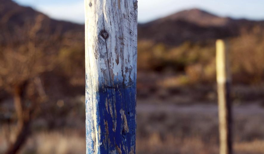This Sunday, March 18, 2018 photo provided by Vansler Nosie Sr. shows what's left of crosses at a prayer site at the Oak Flat Campground in Superior, Ariz. A group known as Apache Stronghold says the site was vandalized over the weekend. The U.S. Forest Service is investigating. (Vansler Nosie Sr. via AP)