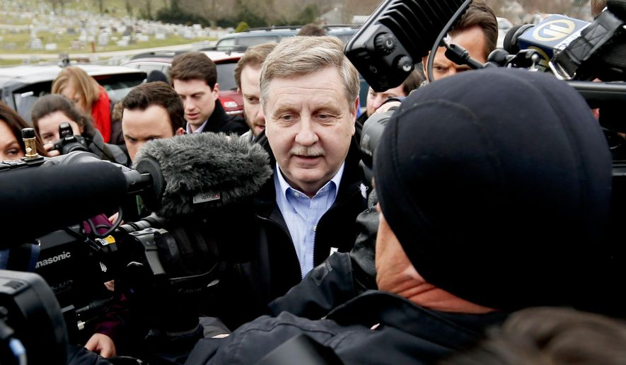 In this Tuesday, March 13, 2018, file photo, Republican Rick Saccone, center, is surrounded by media as he heads to a polling place in McKeesport, Pa., to cast his ballot in a special U.S. House election. Saccone lost the election to Democrat Conor Lamb. (AP Photo/Keith Srakocic, File)
