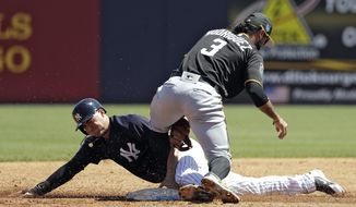 New York Yankees' Tyler Wade is tagged out by Pittsburgh Pirates third baseman Sean Rodriguez (3) attempting to steal second base during the third inning of a spring training baseball game Thursday, March 15, 2018, in Tampa, Fla. (AP Photo/Chris O'Meara)