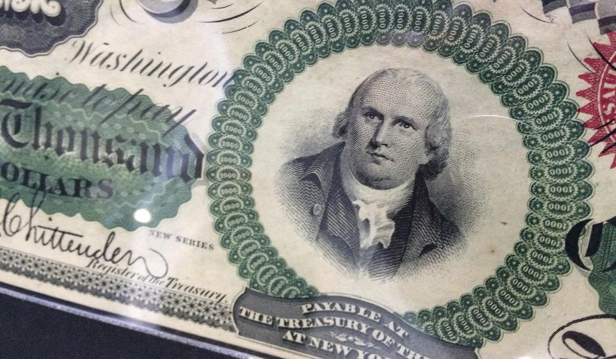 A depiction of Declaration of Independence signer Robert Morris is seen on the front of an 1863 $1,000 bill, Wednesday, March 21, 2018, in Baltimore. The rare bill is expected to sell for around $1 million when it goes up for auction in Baltimore Thursday. (AP Photo/Courtney Columbus)