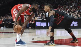 Houston Rockets guard James Harden looks to get past Portland Trail Blazers guard Damian Lillard during the first half of an NBA basketball game in Portland, Ore., Tuesday, March 20, 2018. (AP Photo/Steve Dykes)