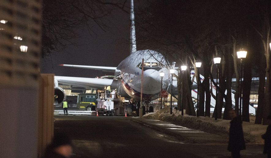 A plane which carried Russian diplomats and their family members ordered to leave Britain as part of a standoff over a nerve agent attack on British soil, at Vnukovo 2 government airport outside Moscow, Russia, Tuesday, March 20, 2018. Nearly two dozen Russian diplomats expelled by Britain over the poisoning of an ex-spy arrived home Tuesday, while a scientist involved in the creation of the nerve agent said it could be manufactured by other countries. (AP Photo/Pavel Golovkin)