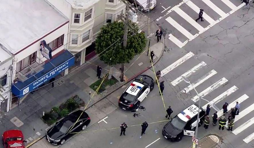 In this photo from video provided by KTVU-TV, San Francisco police officers cordon off the scene of a shooting that left an officer and a suspect wounded with non-life threatening injuries in the city's Mission District, Wednesday, March 21, 2018. The San Francisco Chronicle reported that the officer and a suspect were each shot in the leg during a shootout at about 4:20 p.m. (KTVU-TV via AP)