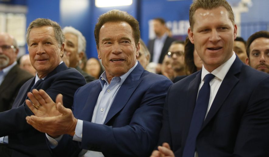 Republican centrists, from left, Ohio Gov. John Kasich, former California Gov. Arnold Schwarzenegger, and New Way California founder, Assemblyman Chad Mayes, attend the first New Way California Summit, a political committee eager to reshape the state GOP, at the Hollenbeck Youth Center in Los Angeles Wednesday, March 21, 2018. (AP Photo/Damian Dovarganes)