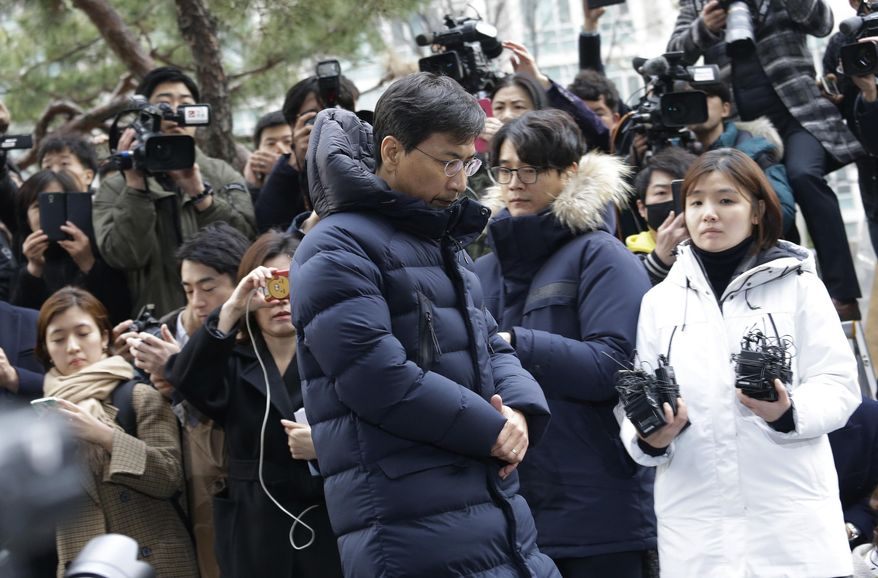 FILE - In this March 9, 2018, file photo, former South Chungcheong Province Gov. Ahn Hee-jung, center, a former presidential contender whose secretary accused him of rape, arrives at the Seoul Western District Prosecutors' Office in Seoul, South Korea. In patriarchal South Korea, the MeToo movement has taken off with unexpected rapidity, toppling male celebrities including a prominent politician. While allegations of sexual abuse began to take toll on reputation of men in power, whether the victims will be able to seek justice and transform the conservative and patriarchal society hinges on changing male-centered views in judicial system and workplaces. (AP Photo/Ahn Young-joon. File)