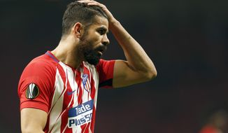 File - In this March 8, 2018 file photo, Atletico Madrid's Diego Costa reacts during the Europa League Round of 16 first leg soccer match between Atletico Madrid and Lokomotiv Moscow at the Metropolitano stadium in Madrid. Spain enters the final stage of its World Cup preparations with coach Julen Lopetegui experimenting up front. Lopetegui has called up several different forwards since taking over the national squad and has plenty of options to choose from before announcing the final list for Russia in a few months (AP Photo/Francisco Seco, File)