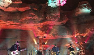 In this Feb. 25, 2018 photo, singer-songwriter Chris Knight, center, and his band perform 333 feet below ground in Cumberland Caverns near McMinnville, Tenn.  Tennessee will soon have not just one, but two caves vying for fans who want to see music performed in a subterranean environment.(AP Photo/Jeff Martin)