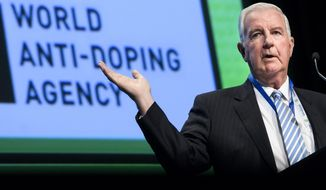 Craig Reedie, world anti-doping agency (WADA) President, delivers his speech during the opening day of the 2018 WADA annual symposium, at the Swiss Tech Convention Center, in Lausanne, Switzerland, on Wednesday March 21, 2018. (Jean-Christophe Bott/Keystone via AP)