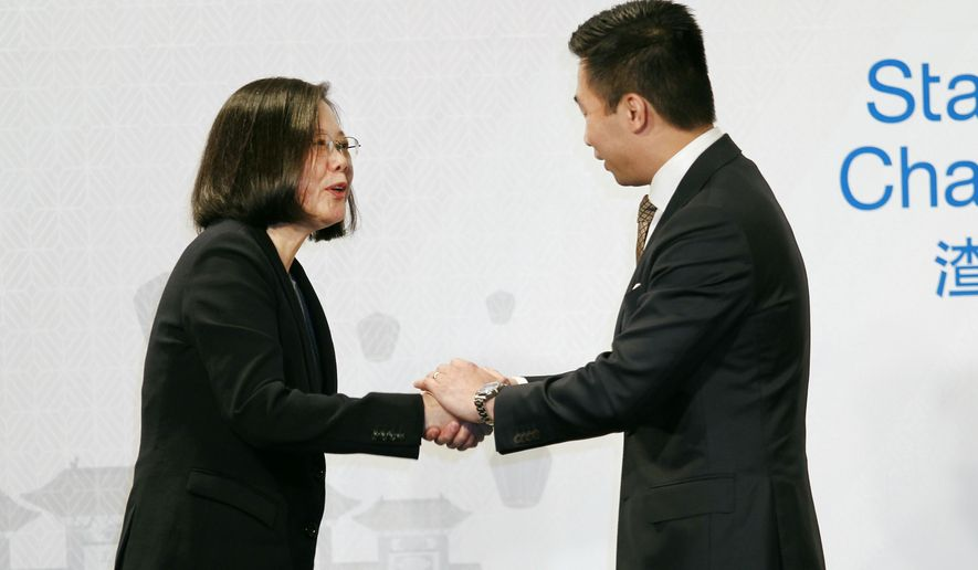 Taiwan's President Tsai Ing-wen shakes hands with Alex Wong, US Deputy Assistant Secretary of State during the 2018 Hsieh Nien Fan of the American Chamber of Commerce in Taipei, Taiwan, Wednesday, March 21, 2018. (AP Photo/Chiang Ying-ying)