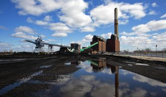 FILE - This April 12, 2016 file photo shows the coal-fired B.C. Cobb Plant generating station in Muskegon, Mich., which closed April 15, 2016. The global fleet of coal-fired power plants is projected to begin shrinking by 2022 as plant retirements outpace new construction, according to a new report that warns the heavily-polluting fuel's decline may not come quickly enough to meet international emission reduction goals. (Joel Bissell//Muskegon Chronicle via AP, File)
