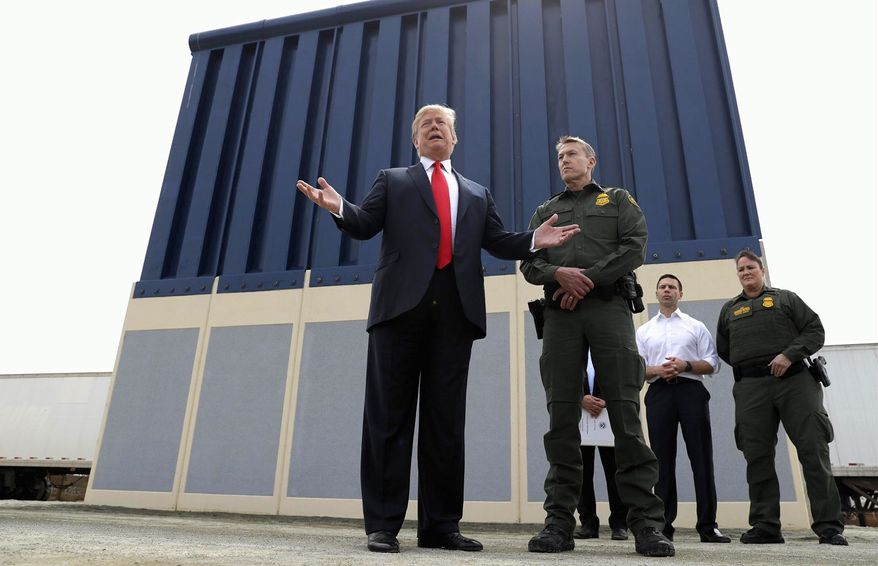 President Trump reviews prototypes for his proposed border wall constructed outside San Diego, California, shown here earlier this month with Rodney Scott, the Border Patrol's San Diego sector chief. (Associated Press)