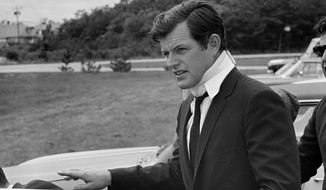 This July 22, 1969, photo shows U.S. Sen Edward Kennedy, D-Mass., arriving back at his home in Hyannis Port, Mass., after attending the funeral of Mary Jo Kopechne in Pennsylvania. A new feature film is in the works about the tragedy on the small Massachusetts island nearly a half century ago that rocked the Kennedy political dynasty. Kopechne drowned when a car driven by Kennedy went off a bridge on Chappaquiddick, a small island in Edgartown, Mass., on the eastern end of Martha's Vineyard in July 1969. (AP Photo/Frank C. Curtin, File)