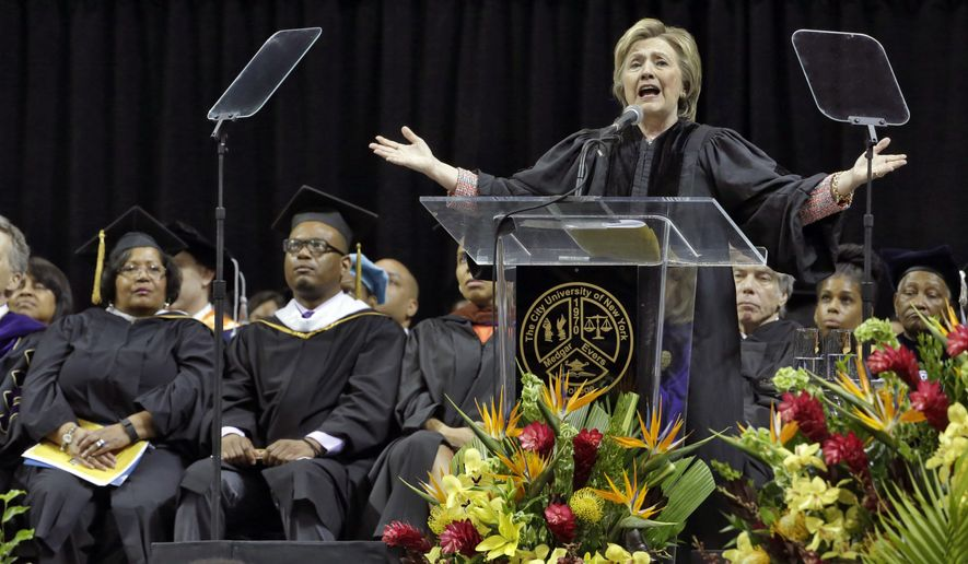 Hillary Clinton delivers the commencement address to Medgar Evers College graduates at Barclay's Center, in Brooklyn, N.Y., Thursday, June 8, 2017. Seated at left are Reena Evers-Everette, and Daniel Evers-Everette, the daughter and grandson of Medgar Evers. (AP Photo/Richard Drew)