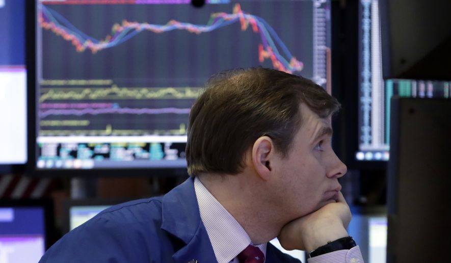 Specialist Thomas Schreck works on the floor of the New York Stock Exchange, Thursday, March 22, 2018. Stocks are falling sharply and bond prices are climbing after the Trump administration moved to place tariffs on some goods imported from China and restrict Chinese investment. (AP Photo/Richard Drew)