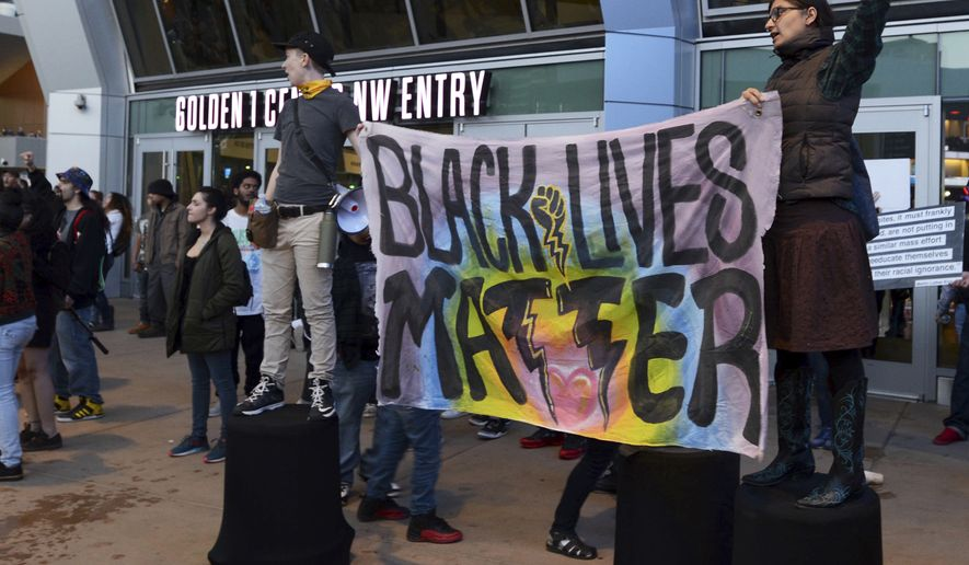 Black Lives Matter and other demonstrators protesting this week's fatal shooting of an unarmed black man gather outside Golden 1 Center before the scheduled tipoff of an NBA basketball game between the Atlanta Hawks and the Sacramento Kings in Sacramento, Calif., Thursday, March 22, 2018. Hundreds of people rallied for Stephon Clark, a 22-year-old who was shot Sunday in his grandparents' backyard. Police say they feared he had a handgun when they confronted him after reports that he had been breaking windows, but he only had a cellphone. (AP Photo/Robert Petersen)