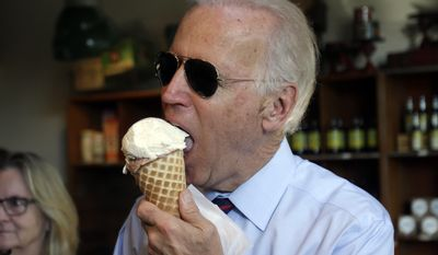 Joe Biden enjoys an ice cream cone after a campaign rally for Oregon U.S. Sen. Jeff Merkley in Portland, Ore., Wednesday, Oct. 8, 2014. Biden was in Portland campaigning for Merkley who is being challenged by Republican Monica Wehby.(AP Photo/Don Ryan)