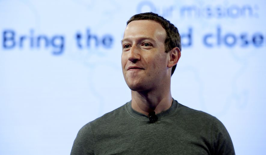 In this June 21, 2017, file photo, Facebook CEO Mark Zuckerberg speaks during preparation for the Facebook Communities Summit, in Chicago. Zuckerberg embarked on a rare media mini-blitz Wednesday, March 22, 2018, in the wake of a privacy scandal involving a Trump-connected data-mining firm. (AP Photo/Nam Y. Huh, File)