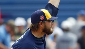 Milwaukee Brewers pitcher Wade Miley throws against the Oakland Athletic's during the first inning of a spring training baseball game Wednesday, March 21, 2018, in Phoenix. (AP Photo/Matt York)