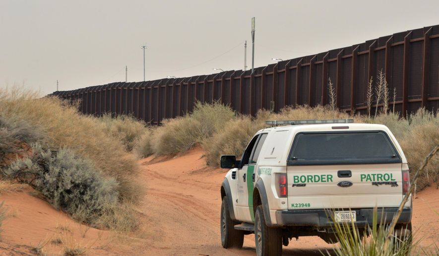 FILE - In this Jan. 4, 2016 file photo, a U.S. Border Patrol agent drives near the U.S.-Mexico border fence in Santa Teresa, N.M. A coalition of environment groups is seeking to stop work to replace existing vehicle barriers along the U.S.-Mexico border in southern New Mexico. The groups filed a lawsuit in U.S. District Court on Thursday, March 22, 2018, claiming the U.S. Department of Homeland Security does not have authority to waive environmental laws as a way to speed construction along a 20-mile stretch near the Santa Teresa port of entry.(AP Photo/Russell Contreras, File)