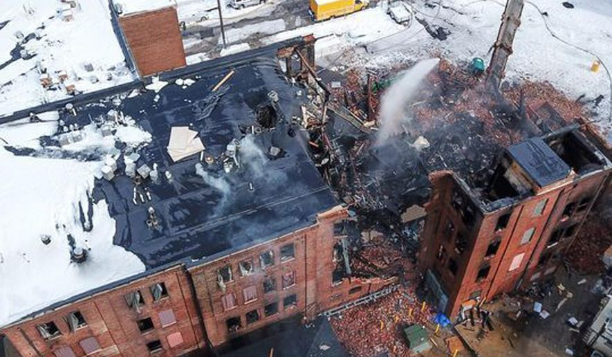 Firefighters work the scene of a fire that started Wednesday in York, Pa., Thursday, March 22, 2018. York officials said part of the four-story building fell on firefighters as they were looking for hot spots and investigating the cause of the fire that broke out Wednesday at the Weaver Organ and Piano factory. (John A. Pavoncello/York Dispatch via AP)