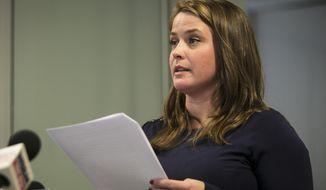 FILE - In this Feb. 13, 2018 file photo, Alaina Hampton, a campaign worker for Illinois Democrats speaks during a news conference, in Chicago. Hampton a former campaign consultant for Illinois House Speaker Michael Madigan is suing his political committee and the state Democratic party, alleging that reporting a top lieutenant for sexual harassment hindered her from advancing in the speaker's organization. Hampton filed the lawsuit Wednesday, March 21, 2018, contending that her effort to stop Madigan aide Kevin Quinn's unwanted advances prevented her from getting further work on Democratic campaigns. (Ashlee Rezin /Chicago Sun-Times via AP, File)