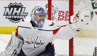 Washington Capitals goaltender Philipp Grubauer (31) stops a Detroit Red Wings shot in the second period of an NHL hockey game Thursday, March 22, 2018, in Detroit. (AP Photo/Paul Sancya) ** FILE **