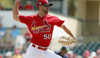 FILE- In this March 1, 2018, file photo, St. Louis Cardinals starting pitcher Adam Wainwright throws during the first inning of an exhibition spring training baseball game against the Minnesota Twins in Jupiter, Fla. Wainwright believes he can still be the best pitcher in all of baseball, even at 36 years old and coming off an injury-riddled 2017 season that was the worst of his illustrious career. (AP Photo/Jeff Roberson, File)