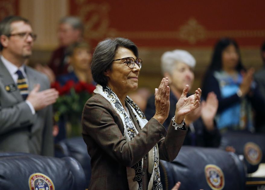 FILE - In this Jan. 11, 2017, file photo, state Sen. Lucia Guzman, D-Denver, applauds during the opening session of the 2017 Colorado Legislature at the Capitol in Denver. Guzman stepped down as minority leader on Thursday, March 22, 2018, citing frustration with majority Republicans' handling of workplace harassment allegations. (AP Photo/Brennan Linsley, File)