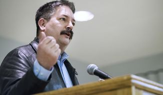 FILE - In this Feb. 8, 2018, file photo, Randy Bryce, a Democratic primary candidate for the 1st Congressional District, addresses supporters at the United Automobile Workers building in Janesville, Wis. National Democrats are endorsing ironworker Bryce in the Wisconsin congressional primary battle for the right to challenge Republican House Speaker Paul Ryan in the November midterm elections.(Angela Major/The Janesville Gazette via AP)