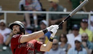 FILE - In this March 14, 2018, file photo, Arizona Diamondbacks' Steven Souza Jr. bats against the Cincinnati Reds during a spring baseball game in Scottsdale, Ariz. Arizona manager Torey Lovullo says Souza likely will open the season on the disabled list after straining his right pectoral muscle while diving for a baseball in a spring training game Wednesday, March 21, 2018. (AP Photo/Chris Carlson, File)