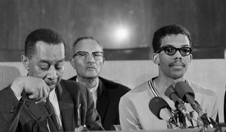 FILE - In this March 23, 1968, file photo, Dr. Kenneth Clark, New York psychologist and member of the board of trustees of Howard University, speaks at a news conference which student leaders in Washington, D.C. From left: Clark, Edward Brown, student council president, Tony Gittens and Q. T. Jackson. The national tumult of 1968 was marked by iconic images, including the campus takeover - students occupying critical campus buildings and shutting down institutions for days. About 1,000 students at Howard University took over the administration building, leading to the shutdown of the school from March 19 through March 23, 1968. (AP Photo/Bob Schutz, File)