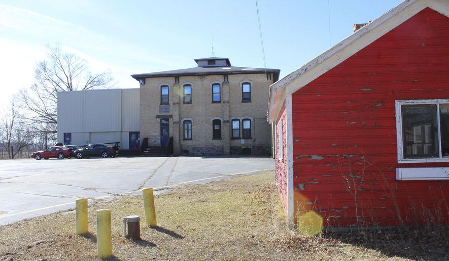 This March 16, 2018 photo shows the former Palo Community School, that was recently purchased by Gary Wright and Ann Witzel in Palo, Mich.  The buyers of the former school building in the small mid-Michigan community say they found two rooms full of bags and boxes of medical records. They bought the building from Dr. Raymond Allard, an orthopedic surgeon who is being investigated by the state following complaints about infections.  (Elisabeth Waldon/The Daily News via AP)
