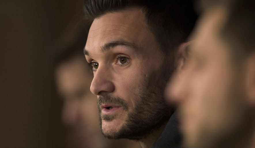 """FILE - In this Monday, Oct. 16, 2017 file picture, Tottenham goalkeeper Hugo Lloris answers to a question during a news conference at the Santiago Bernabeu stadium in Madrid, Spain. Tottenham captain Hugo Lloris says in an AP interview that Spurs, which plays Manchester United in the FA Cup semi-finals next month, deserves a trophy because of its """"attractive,"""" risk-taking football. (AP Photo/Francisco Seco, File)"""