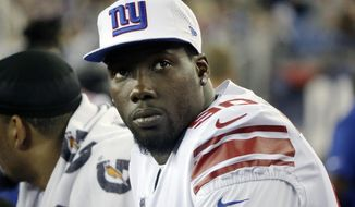 FILE - In this Aug. 31, 2017, file photo, New York Giants defensive end Jason Pierre-Paul watches from the sideline during the second half of an NFL preseason football game against the New England Patriots, in Foxborough, Mass. A person familiar with the deal says the Giants have traded defensive end Jason Pierre-Paul to the Tampa Bay Buccaneers for two draft picks. The person spoke on condition of anonymity Thursday, March 22, 2018,  because neither team has announced the deal that gets Tampa Bay the former first-round draft pick whose career was interrupted by a fireworks accident in 2015 that severely damaged his right hand.(AP Photo/Steven Senne, File)