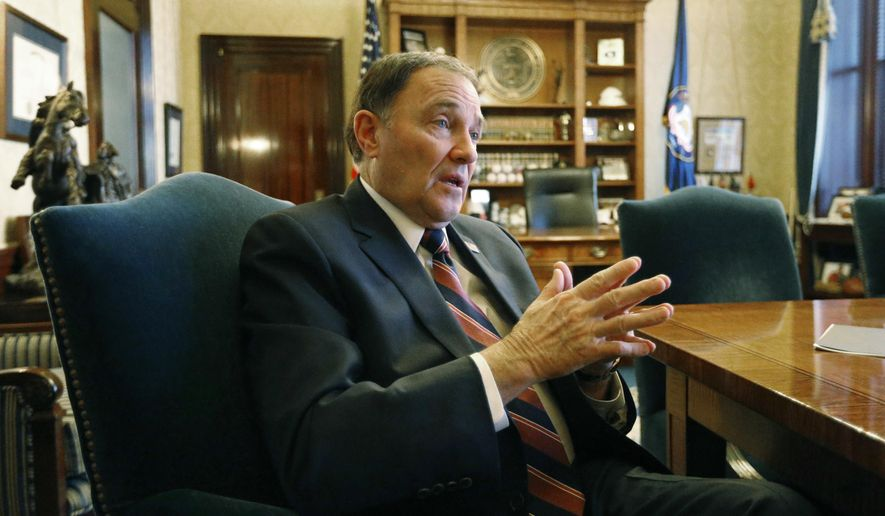 "FILE - In this March 8, 2018, file photo, Utah Gov. Gary Herbert speaks during an interview at the Utah state Capitol, in Salt Lake City. Herbert says he isn't sure yet whether he'll be calling lawmakers into a special session this year to address gun violence and school shootings as some lawmakers have suggested. Herbert said at his monthly televised news conference at KUED Thursday, March 22 that he wouldn't plan to call a special session unless there's consensus on ideas that are ""not just a feel good thing "" but will make concrete improvements. (AP Photo/Rick Bowmer, File)"