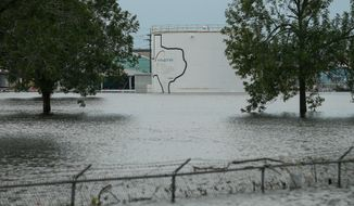 In this Aug. 30, 2017 photo, the Arkema chemical plant is flooded from Hurricane Harvey in Crosby, Texas, northeast of Houston. Nearby residents complain of a 'bitter taste' about the sparse information authorities provided when chemicals at the plant caught fire. They say the company failed to provide sufficient warning beforehand while environmental officials misled them with assurances that the air and water were safe. Critics say testing by authorities and contractors was inadequate to determine whether public health was threatened. (Godofredo A. Vasquez/Houston Chronicle via AP)