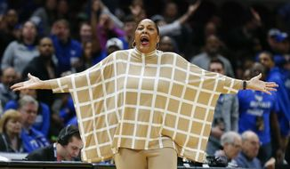 """FILE - In this March 10, 2018, file photo, Buffalo head coach Felisha Legette-Jack reacts to a foul call during the second half of an NCAA college basketball game against Central Michigan in the championship of the Mid-American Conference tournament, in Cleveland. Once her coaching career collapsed at Indiana, and Felisha Legette-Jack considered walking away from basketball entirely, she made one promise if ever another opportunity arose. Upon being hired to take over Buffalo's flagging women's basketball program in 2012, Legette-Jack vowed she was going to be her bold, brash, boisterous self rather than attempt fitting someone else's prim and boxy notion of how a coach is supposed to behave. """"Yeah, I was afraid to be me,"""" Legette-Jack told The Associated Press this week. (AP Photo/Ron Schwane, File)"""