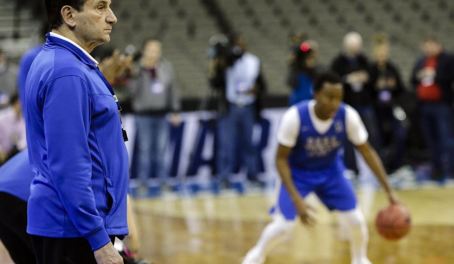 Duke coach Mike Krzyzewski, left, follows practice at the NCAA men's college basketball tournament, in Omaha, Neb., Thursday, March 22, 2018. Duke faces Syracuse in a regional semifinal on Friday. (AP Photo/Nati Harnik)