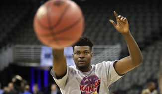 Kansas center Udoka Azubuike takes part in a shooting drill during practice at the NCAA men's college basketball tournament, Thursday, March 22, 2018, in Omaha, Neb. Kansas faces Clemson in a regional semifinal on Friday. (AP Photo/Charlie Neibergall)