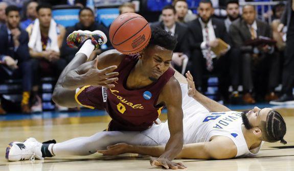 Loyola-Chicago guard Donte Ingram (0) falls over Nevada forward Caleb Martin (10) during the second half of a regional semifinal NCAA college basketball game, Thursday, March 22, 2018, in Atlanta. (AP Photo/David Goldman)