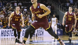 Loyola-Chicago guard Marques Townes reacts to hitting a 3-pointer in the final minute of the team's 69-68 victory over Nevada during an NCAA men's college basketball tournament regional semifinal Thursday, March 22, 2018, in Atlanta. (Curtis Compton/Atlanta Journal-Constitution via AP)