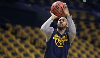 West Virginia's Jevon Carter shoots during practice at the NCAA men's college basketball tournament in Boston, Thursday, March 22, 2018. West Virginia faces Villanova in a regional semifinal on Friday. (AP Photo/Charles Krupa)