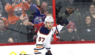 Edmonton Oilers center Connor McDavid (97) celebrates his goal against the Ottawa Senators during second-period NHL hockey in Ottawa, Thursday, March 22, 2018. (Fred Chartrand/The Canadian Press via AP)