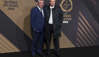 Portugal national team coach Fernando Santos and Brazilian coach Luis Felipe Scolari, right, arrive for the Portuguese soccer federation awards ceremony Monday, March 19, 2018, in Lisbon. (AP Photo/Armando Franca)