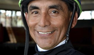 In this Sept. 19, 2015 photo, provided by Equi-Photo, jockey Jose Flores poses at Parx Racing in Bensalem, Pa. Flores, 56, who was among the best jockeys in Pennsylvania history, died Thursday, March 22, 2018, of injuries suffered in a racing accident, Parx Racing said in a statement. Flores was racing Monday, March 19, in Bensalem, when his horse went down and he was thrown off. The jockey won 4,650 races in a career that spanned more than three decades. (Barbara Weidl/EQUI-PHOTO via AP)