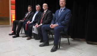 The four Republican candidates for U.S. Senate wait to debate at Montana State University on Thursday, March 22, 2018, in Bozeman, Montana. From left, Russell Fagg, Troy Downing, Matt Rosendale and Al Olszewski are competing for the chance to challenge Democratic Sen. Jon Tester this fall. (AP Photo/Matt Volz)